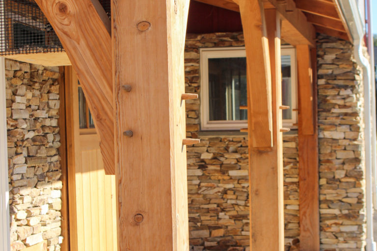 heavy timber frame amish built barn porch