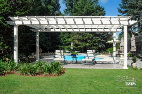 large pergola by a pool what is the purpose of a pergola