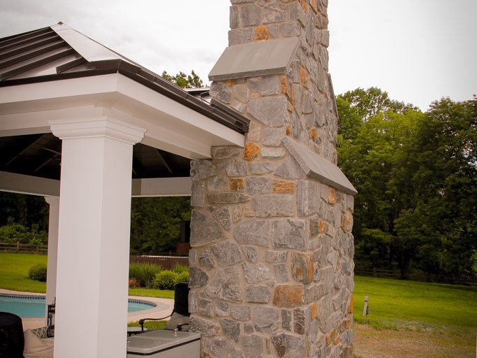 chimney idea of poolhouse pavilion design with fireplace by amish builders in lancaster pa