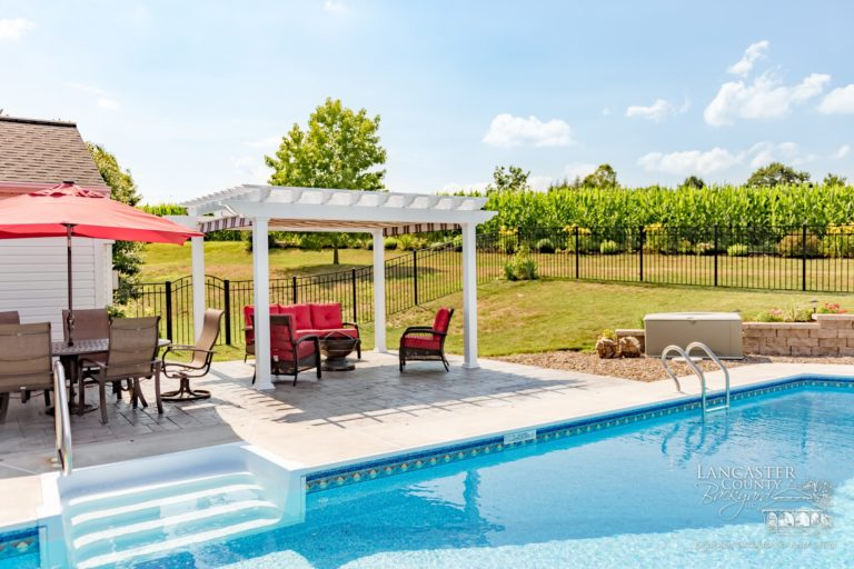 retractable pergola canopy creates a classy poolside shade cover