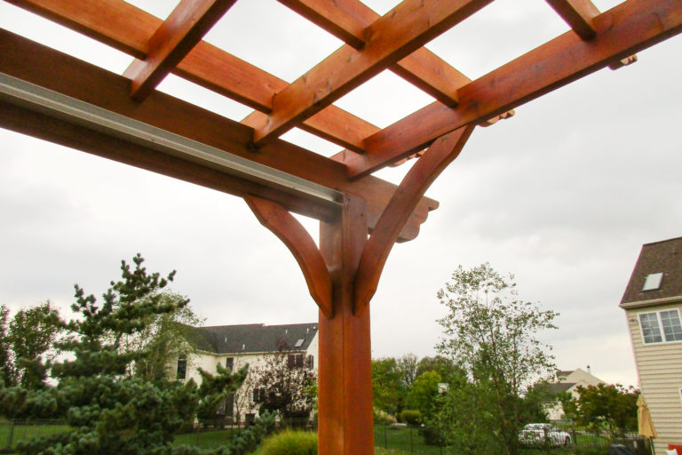 edge of a wooden backyard pergola