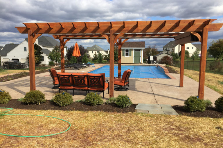 cedar pergola in a backyard