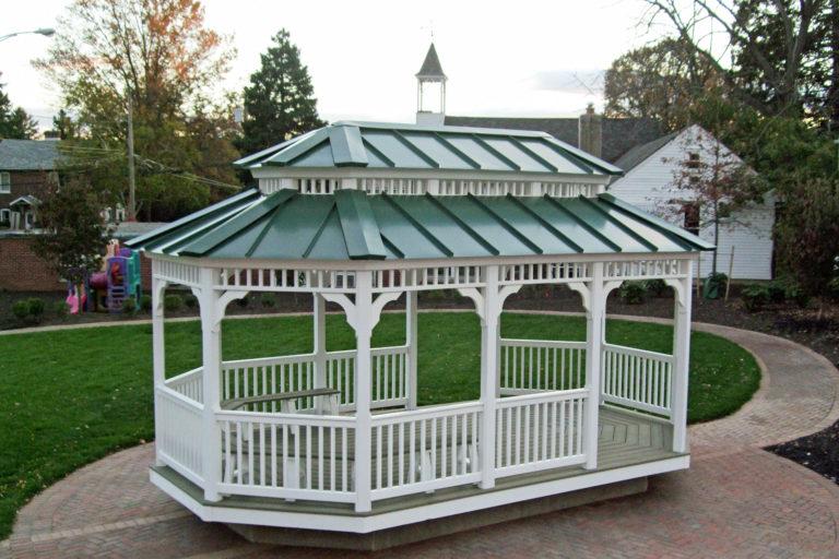vinyl oval gazebo in park setting