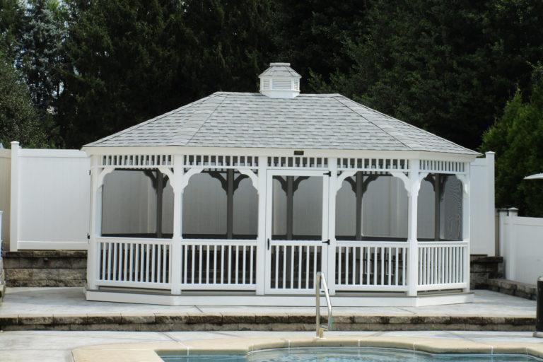 oval vinyl gazebo by the pool
