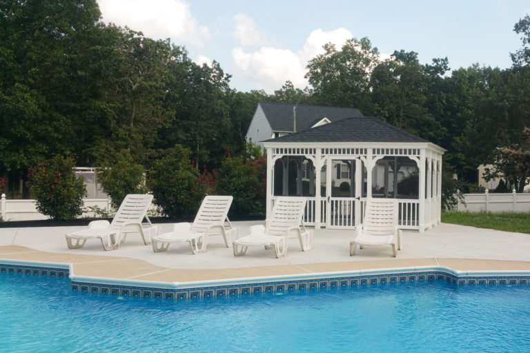 rectangular portable gazebo beside a swimming pool