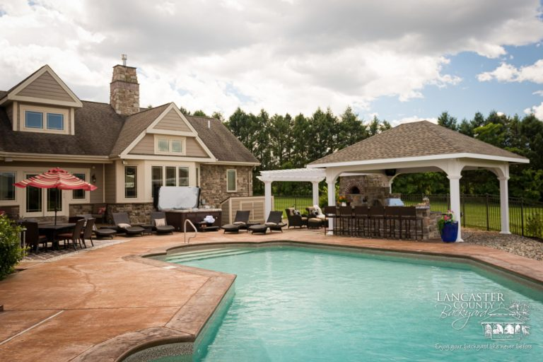 custom poolside pergola and pavilion with outdoor furniture