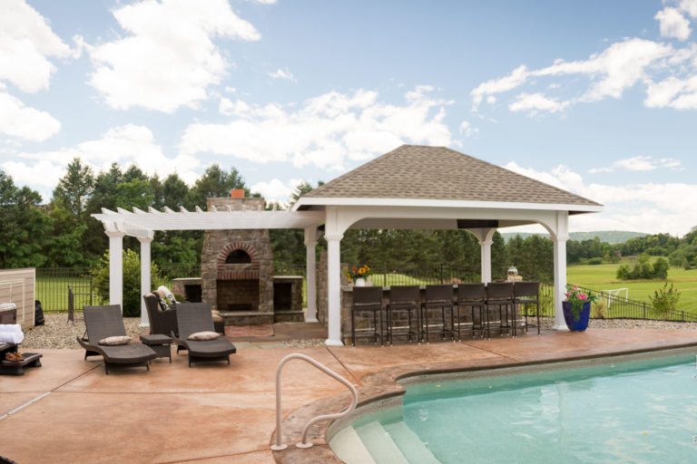pergola and pavilion with a hot tub and a pool