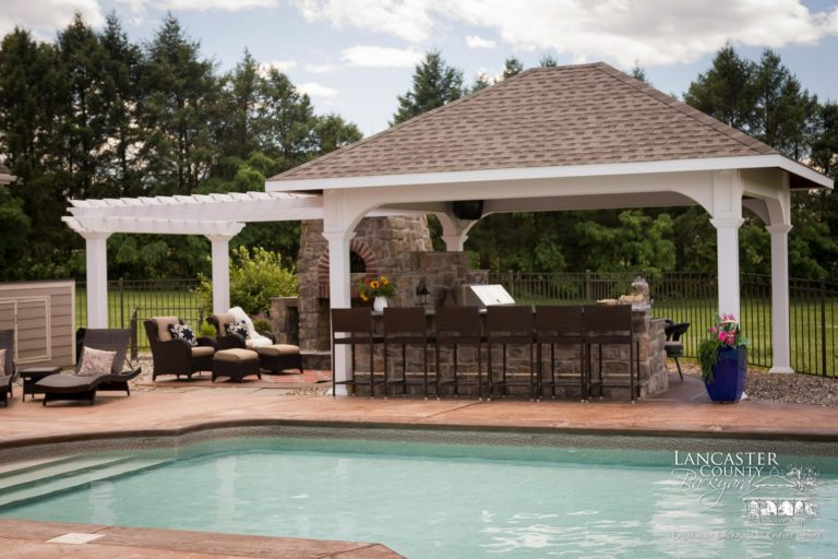 poolside pergola and pavilion with outdoor kitchen