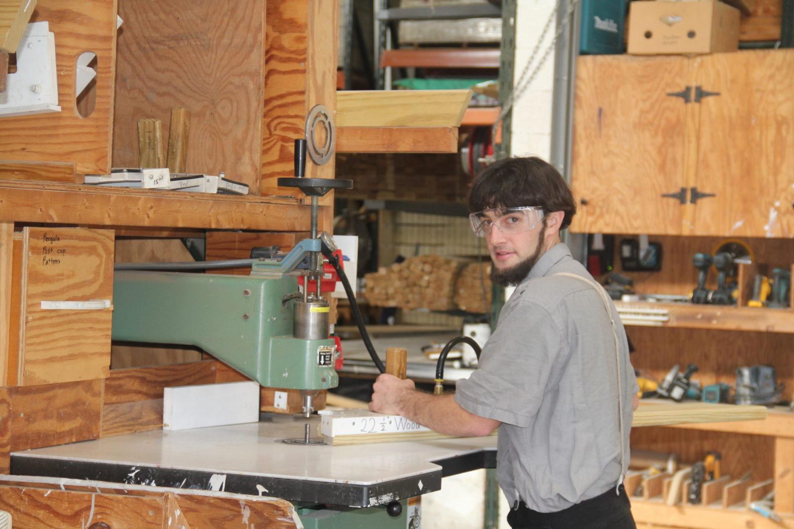 amish carpenter working on an amish pavilion
