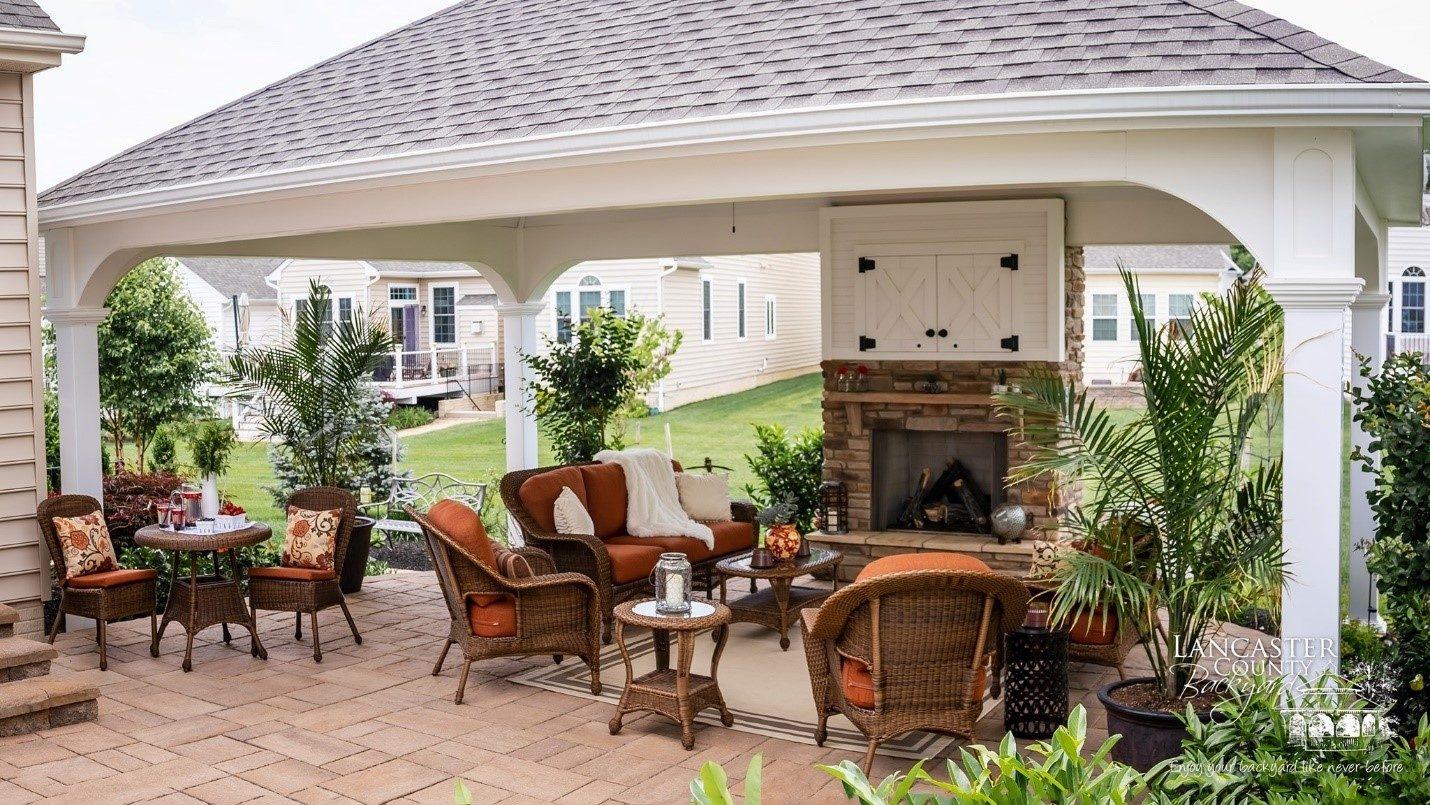 outdoor fireplace under pavilion interior