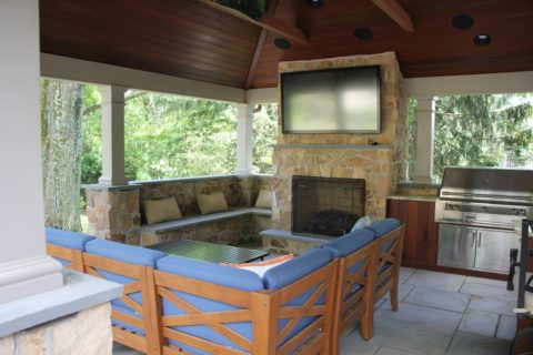 seating area outdoor fireplace under pavilion