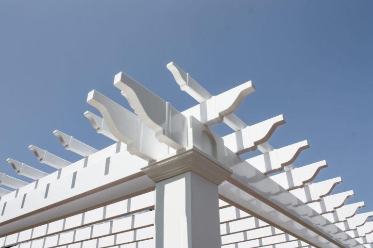 top of a vinyl pergola with slats and beams