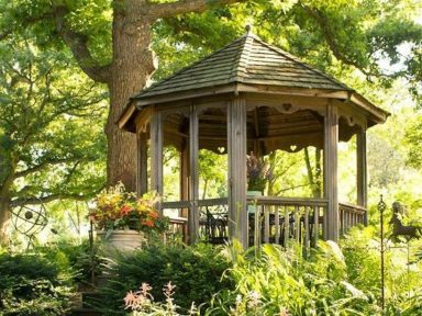 A Permanent Irresistible Gazebo In The Backyard With Some Beautiful Pink Flowers In 2020